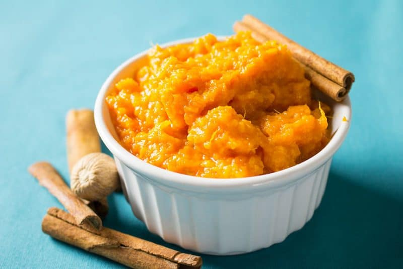 Close-up Mashed Sweet Potatoes and Honey in white bowl