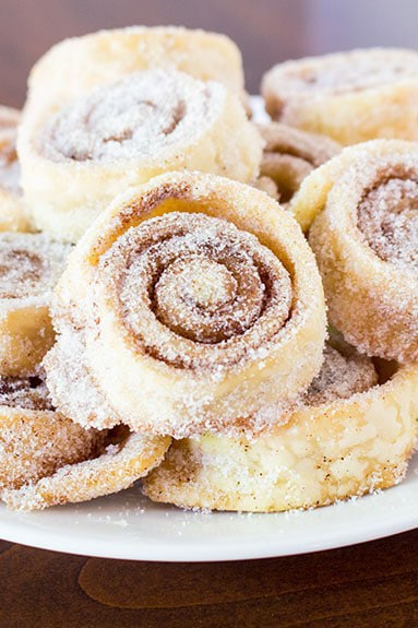 Sugar Cinnamon Pie Crust Pinwheel Cookies are super simple cookies made with just 4 ingredients. Butter, sugar, and cinnamon rolled in pie crusts are baked into a delicious cookie. Beginner friendly recipe!