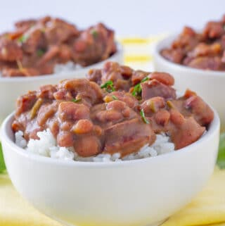 Red beans and sausage over rice in a white bowls