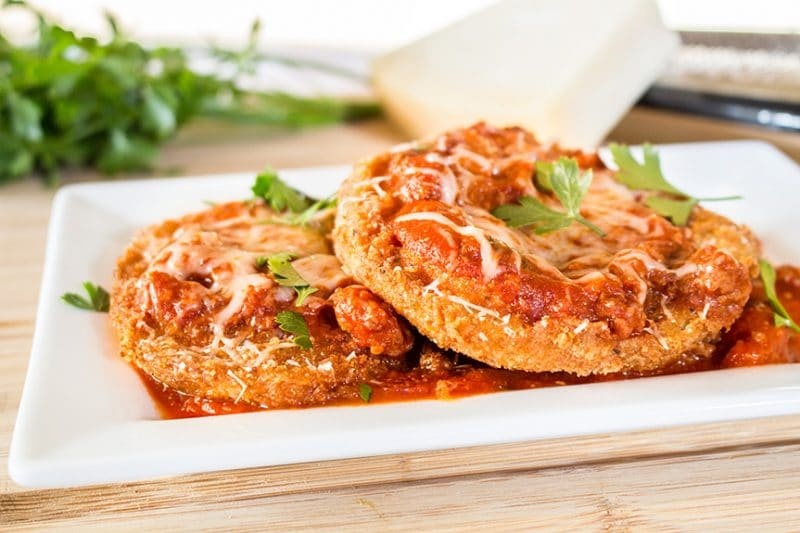 Eggplant Parmesan on square white plate
