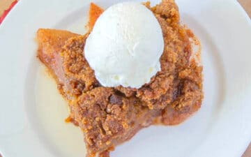 Apple Crisp with ice cream on a white plate