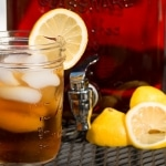 Sun Tea in glass with lemons and ice