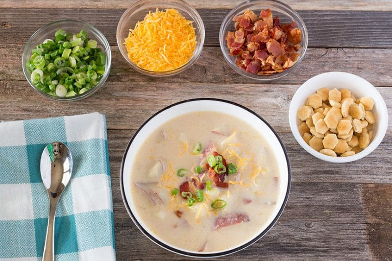 Overhead Loaded Baked Potato Soup with toppings