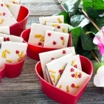 Dark Chocolate Cherry Bark in heart shaped bowls and roses