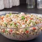 Bulgar chickpea salad in clear bowl