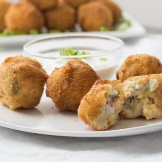 Deep Fried Loaded Mashed Potato Bites on White Plate