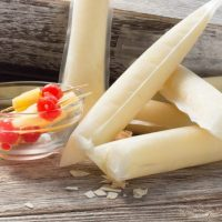 Pina Colada Spiked Popsicle with cherries and pienapple