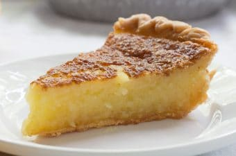 Close-up chess pie on white plate