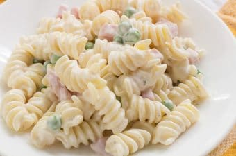 Rotini pasta in ranch flavored dressing with peas and ham