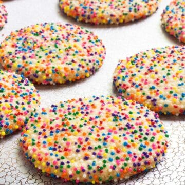 Sprinkle Cookies on a cookie sheet