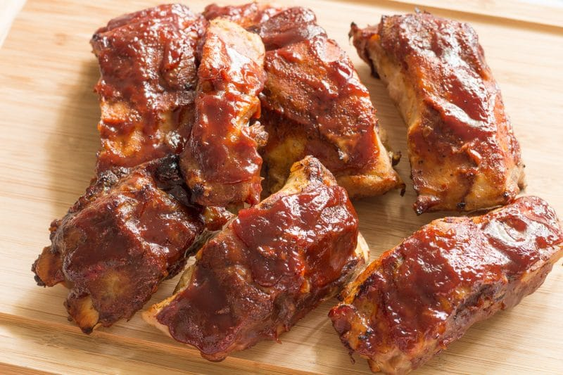 Slow cooker BBQ ribs on a cutting board