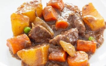 Beef stew with carrots and potatoes on a plate