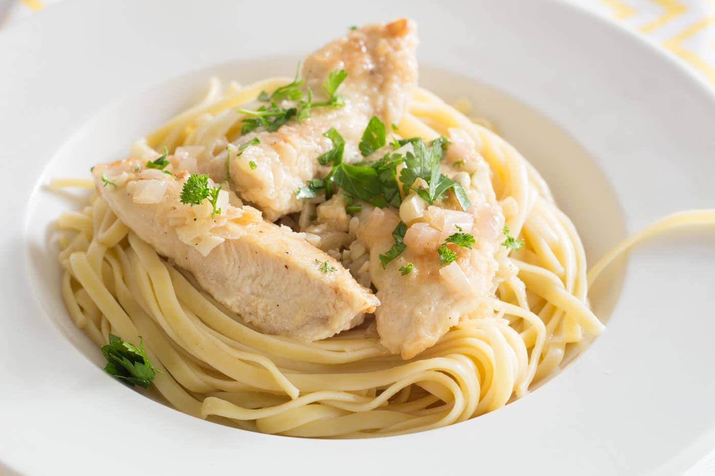 chicken scampi with parlsey on linguine