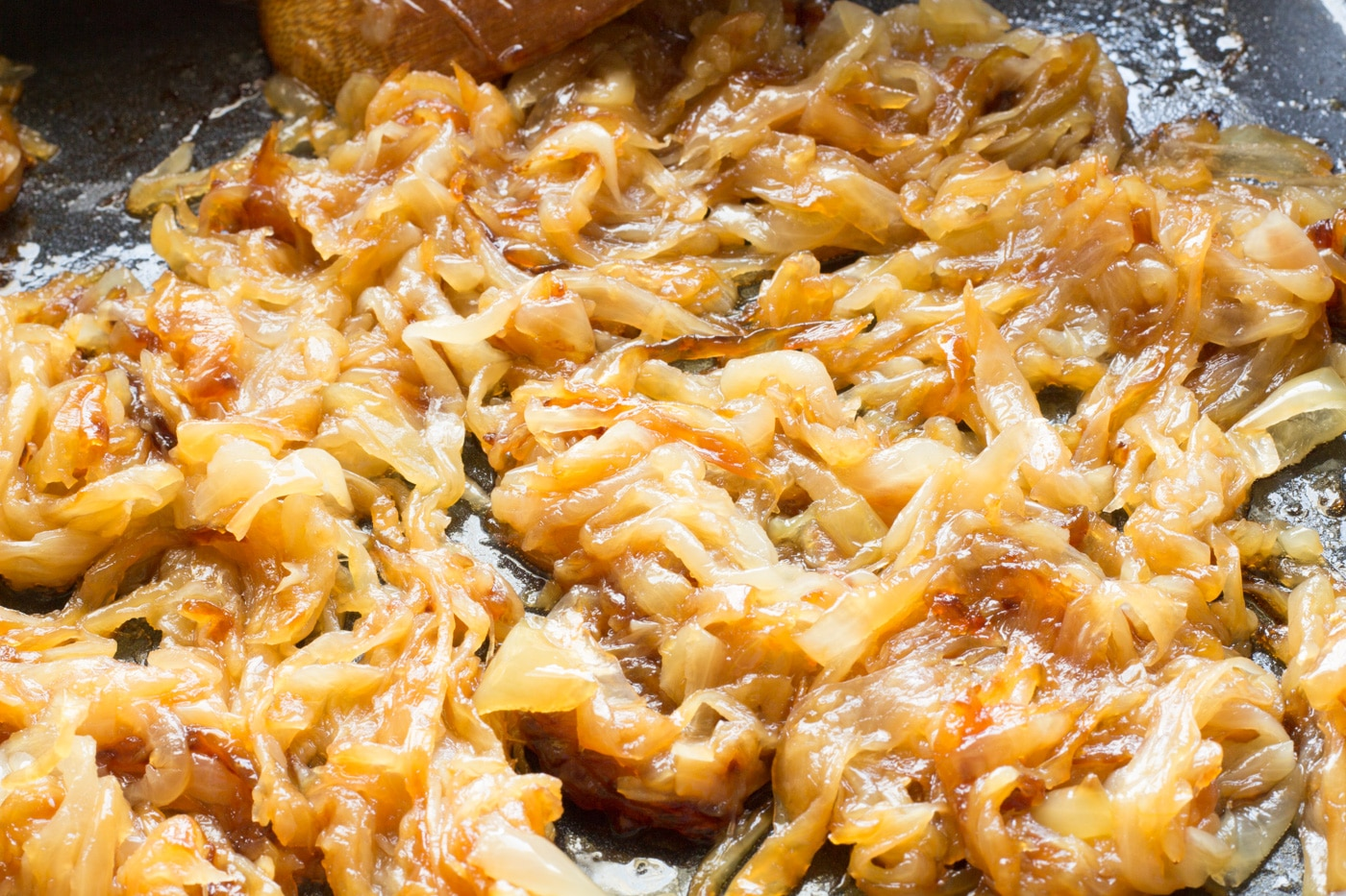 Caramelized onions cooking in an electric skillet