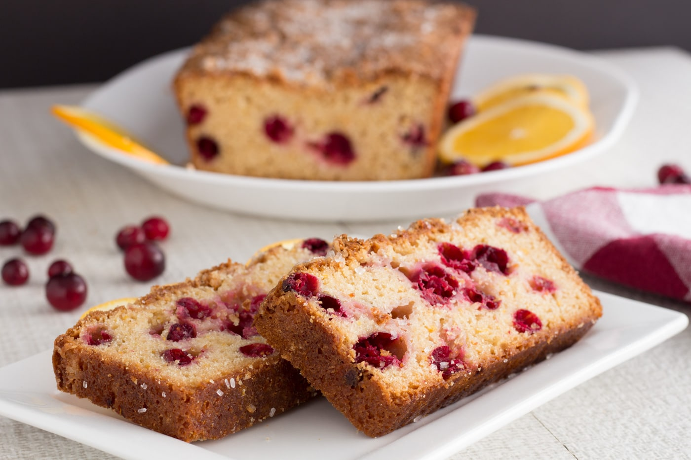 Slices of quick bread with cranberries on a plate