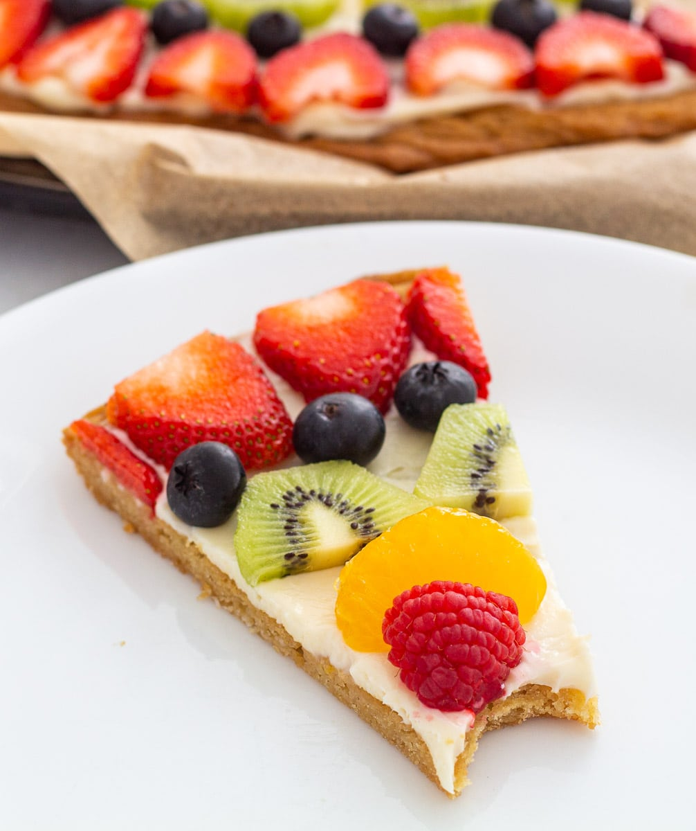 Fruit pizza with a bite out of it